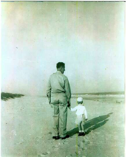 Albert Halff walks on the beach in Myrtle Beach, S.C. where he was stationed during World War II wit
