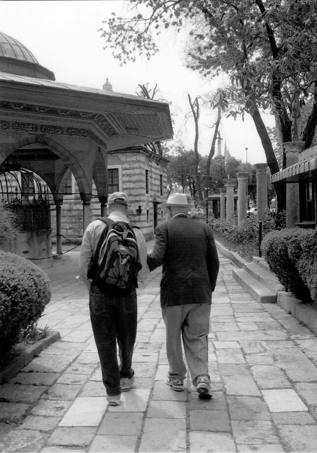 "Albert Halff, 92, walks with his son Henry, 65, during a visit to Istabnbul in 2008. Albert Halff is now 96 and, according to his son, ""still alive and kicking."" Photo: COURTESY"