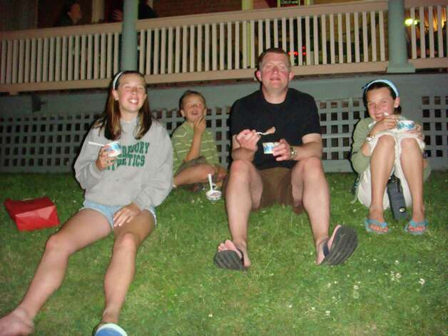 In June, 2007 Mary Biediger, 14, William Biediger, 9, their uncle Scott Lemme and Erin Biediger, 12, enjoying Herrell's ice cream in Northampton, Mass. where Lemme lives. Photo: COURTESY