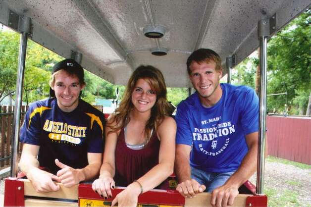 "Siblings Clinton, 22, Emily, 18, and Brett Bippert, 20, ride the Breckenridge Park Train on June 4, 2012. From their mother, Frances Bippert: ""17 years [after taking a similar photo], this photo was taken on June 4, 2012, the same day Clinton was reporting to Navy boot camp in Illinois.  We wanted a family photo and decided to go back to Clinton's favorite place, that held such great memories."" Photo: COURTESY"
