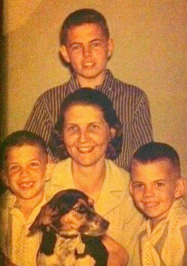 Mazola Collins poses with her sons Jim (standing), Jay (left), Jodie (right) & their beloved dog Trixie c. 1962. Photo: COURTESY