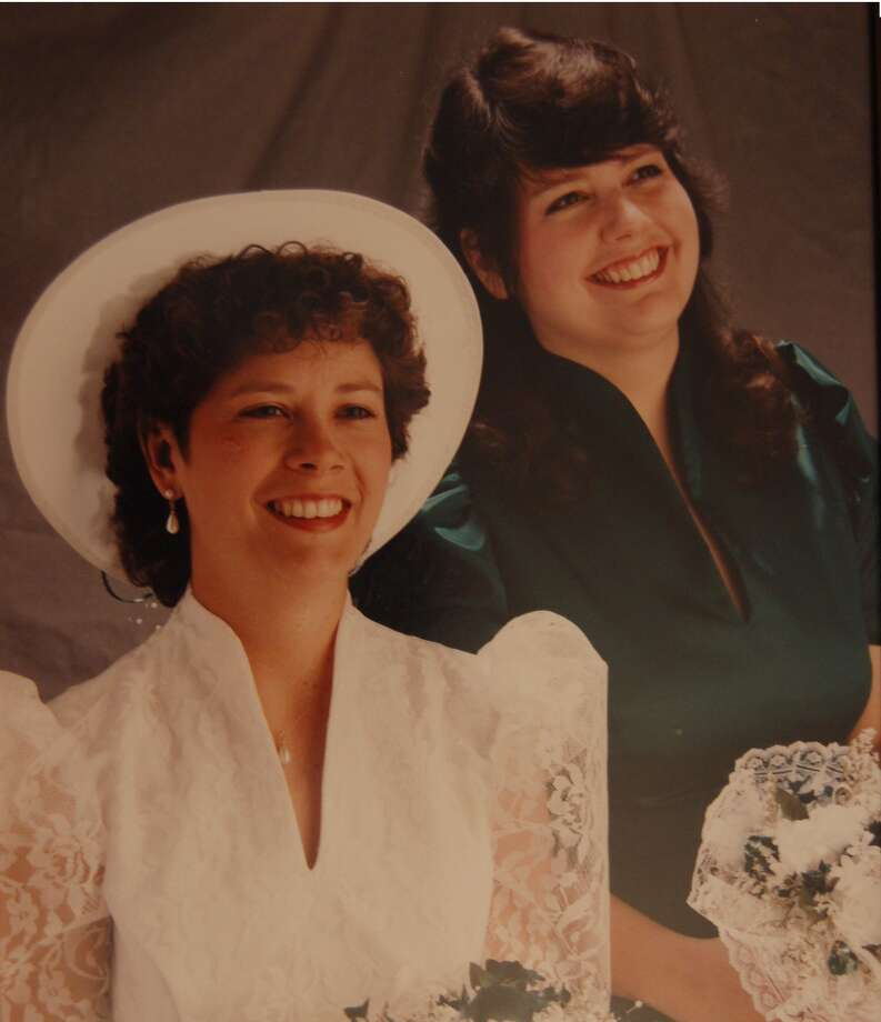 Sisters Melanie Villalobos and Valerie Hall re-create an original photo from 1964 during Melanie's wedding in 1992. Photo: COURTESY