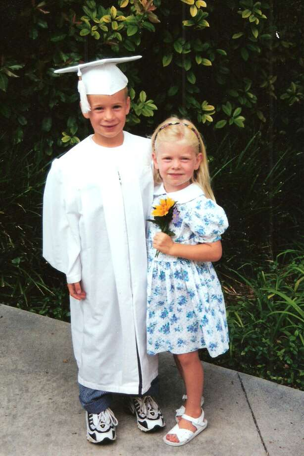 Davis McCracken, 6, celebrates his graduation from kindergarten at San Antonio Christian School with his sister Bailey, 4, in May 2000. Photo: COURTESY