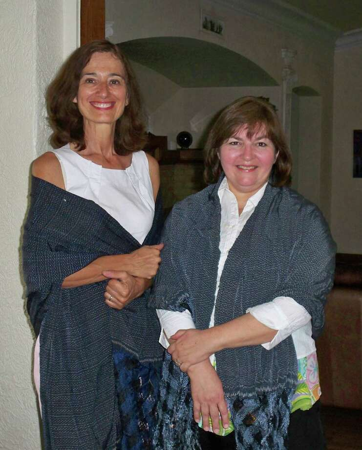 Cousins Cynthia Eloisa Smith Spielman, 56, and Debbi Josephine Robinson Zimmerle, 54 during Fiesta 2012. They wearing the same sybarite rebozo shawls that wore in a similar photo taken in 1970. Photo: COURTESY