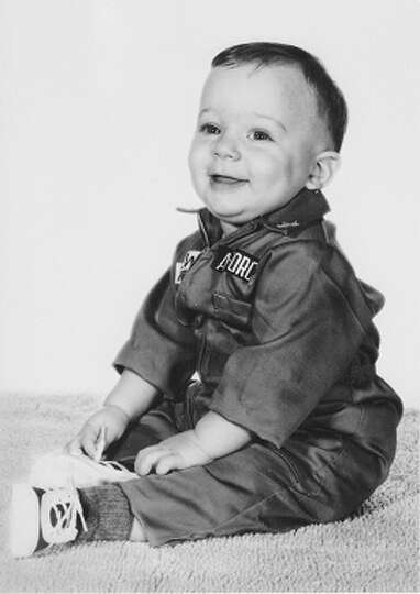 Andy Crews, nine months, wears a miniature USAF jump suit in Waco in December 1968