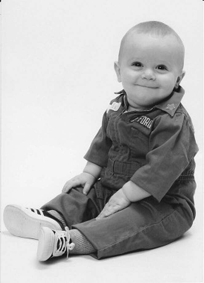 Now: Matthew Crewes, nine months and the son of Andy Crewes, wears the same miniature USAF jump suit his father Andy Crewes wore in 1968. This photo was taken in San Antonio in December 1968 Photo: COURTESY