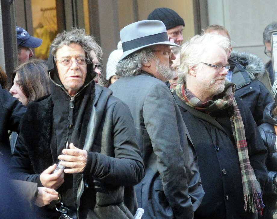 Lou Reed, left, and Philip Seymour Hoffman were among the mourners at the funeral for the three Badger sisters, Lilian, Sarah and Grace, at St. Thomas Church Fifth Avenue in Manhattan, N.Y., on Thursday, Jan. 5, 2012. Photo: Keelin Daly / Stamford Advocate