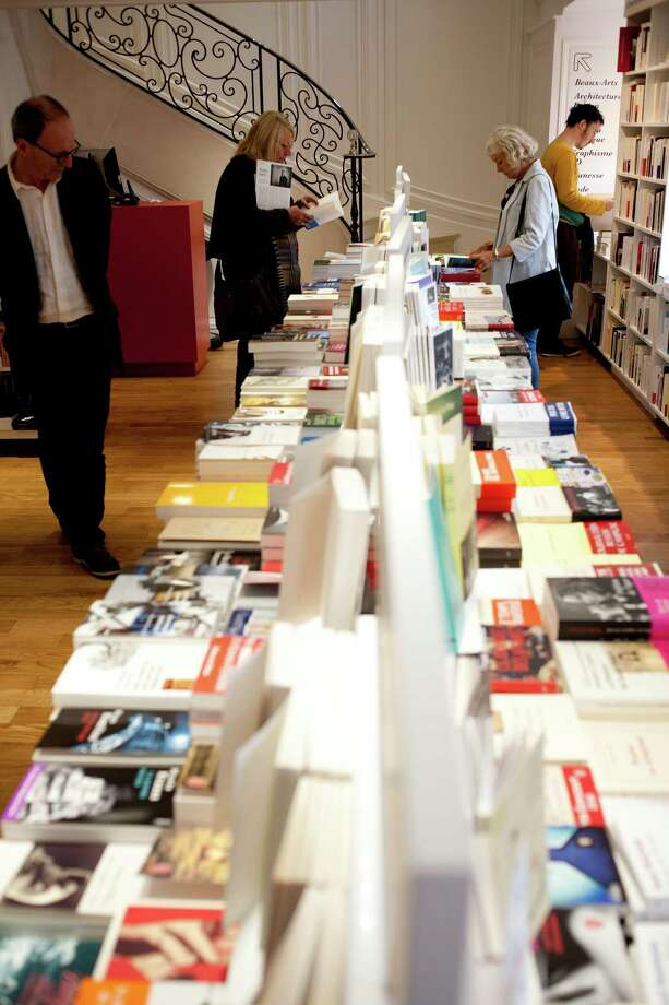 As independent bookstores in the U.S. and Britain struggle to survive, French booksellers, like La Hune bookstore in Paris, continue to prosper with the help of the government. Photo: ALICE DISON / NYTNS