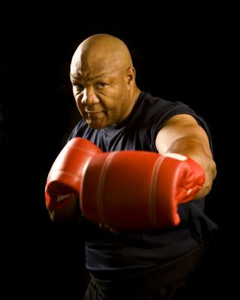 Challenge George Foreman to a round of boxing.  (Robert Seale / For the Chronicle)