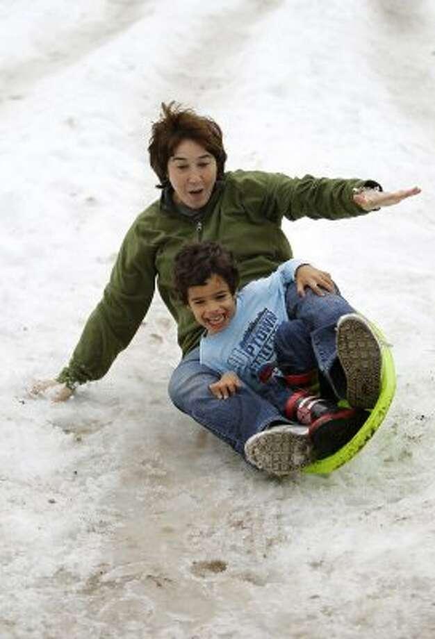 Go sledding in Discovery Green.  (Karen Warren / Houston Chronicle)