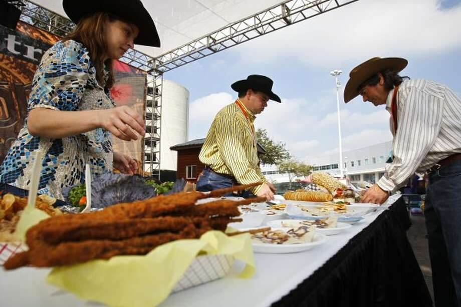 Eat everything served fried or on a stick at the Houston Rodeo.  (Michael Paulsen / Chronicle)