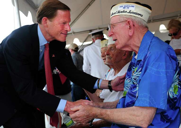 Navy veteran Floyd Welch, 91, of East Lyme, talks with Sen. Richard Blumenthal during a ribbon cutti