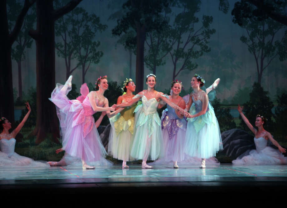 New England Dance Theater performed its final 2012 spring performance, the ballet ìA Midsummer Nightís Dreamî at the New Canaan High School last week. Pictured, the dancers dance in the production. New Canaan, Conn. Photo: Contributed Photo