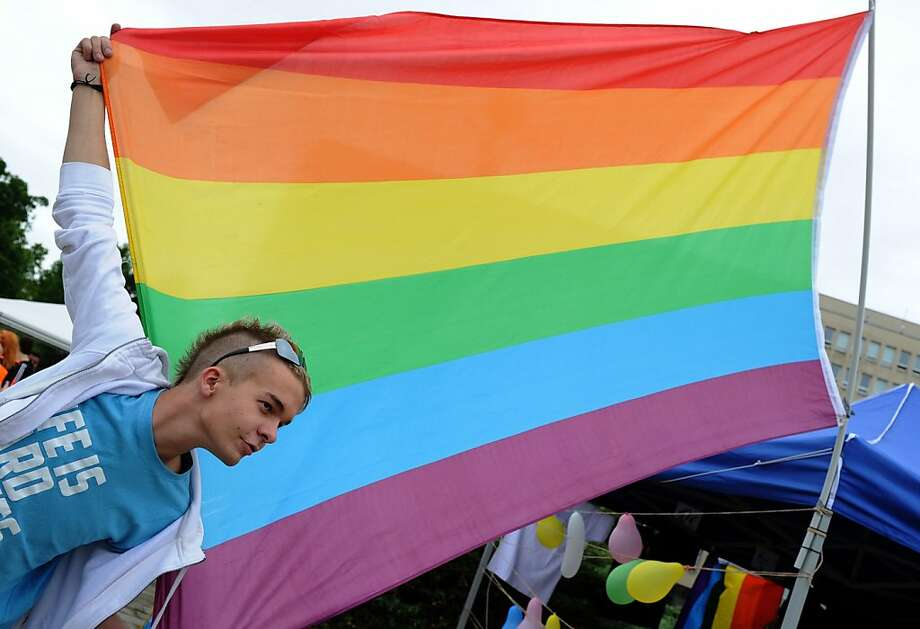A demonstrator holds a rainbow flag in Bratislava on June 9,2012, during the Rainbow Pride Parade, a march for the human rights of non-heterosexual people and the celebration of LGBT (lesbian, gay, bisexual, transgender) pride in Slovakia. AFP PHOTO/SAMUEL KUBANISAMUEL KUBANI/AFP/GettyImages Photo: Samuel Kubani, AFP/Getty Images