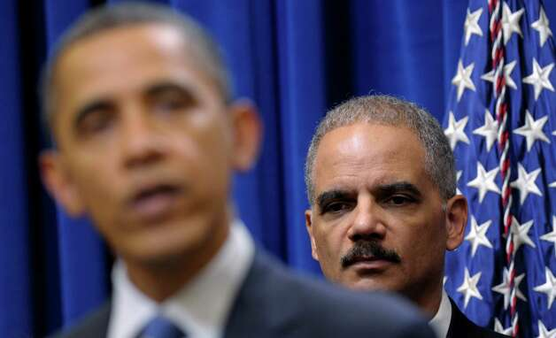FILE - In this Feb. 9, 2012 file photo, Attorney General Eric holder listens at right as President Barack Obama speaks about a mortgage settlement in the Eisenhower Executive Office building on the White House complex in Washington.   Wednesday, President Obama refused to turn over some Justice Department documents about a botched anti-smuggling operation that allowed hundreds of guns sold in Arizona to end up in Mexico. Because of the standoff, the House Government Oversight and Reform Committee then voted to hold Attorney General Eric Holder in contempt of Congress. Photo: AP