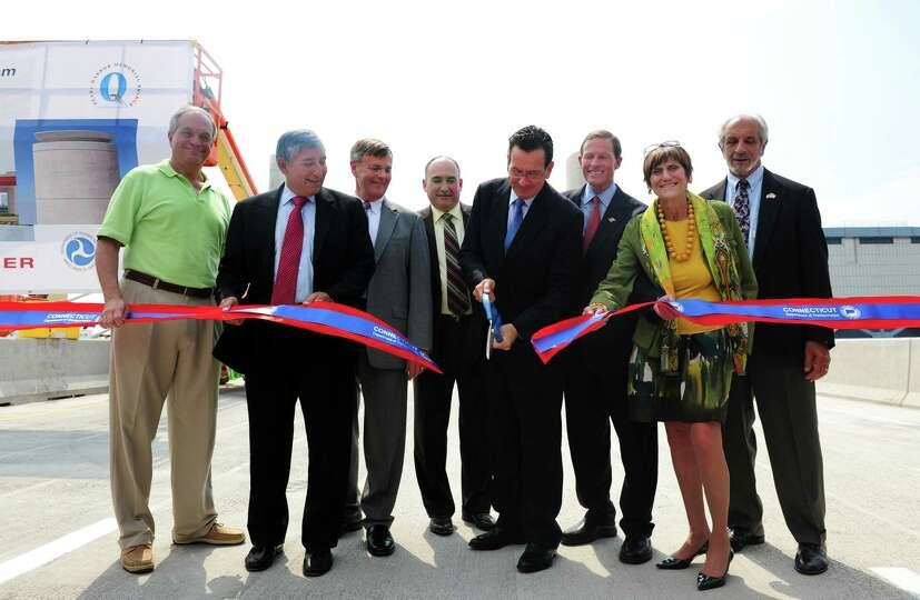 Gov. Dannel P. Malloy and other dignitaries cut the ribbon at a ceremony to mark the opening of the