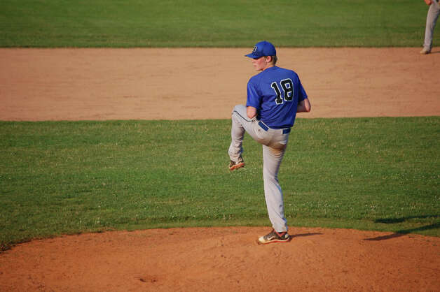Darien's Peter Meadows prepares to throw a pitch against Westport Thursday. Meadows gave up two unearned runs on four hits in a 2-1 loss. Photo: Robert Chasin / Contributed Phot