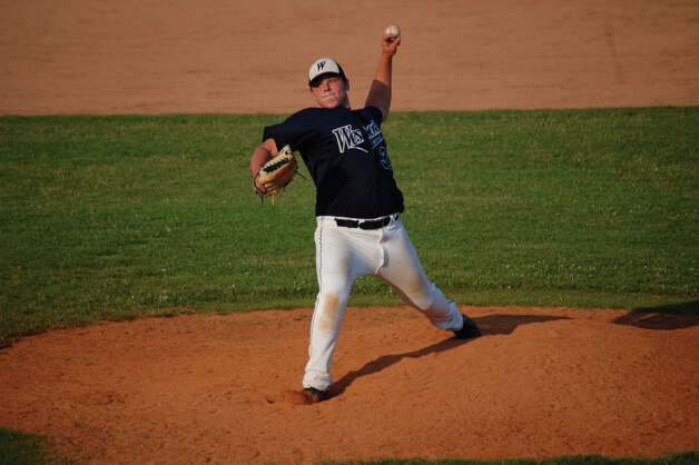 Westport lefty Chris Speer prepares to release a pitch against Darien Thursday. Speer allowed a run on five hits in five innings and got out of two jams unscathed in a 2-1 win. Photo: Robert Chasin / Contributed Phot
