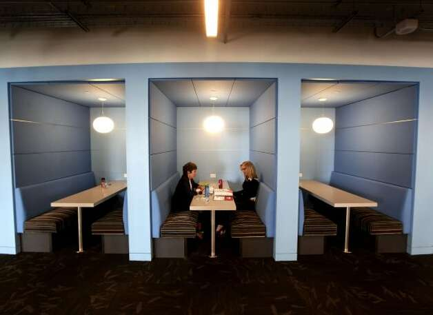 Employees work from one of the casual meeting areas in Twitter's new headquarters. (Michael Macor / The Chronicle)