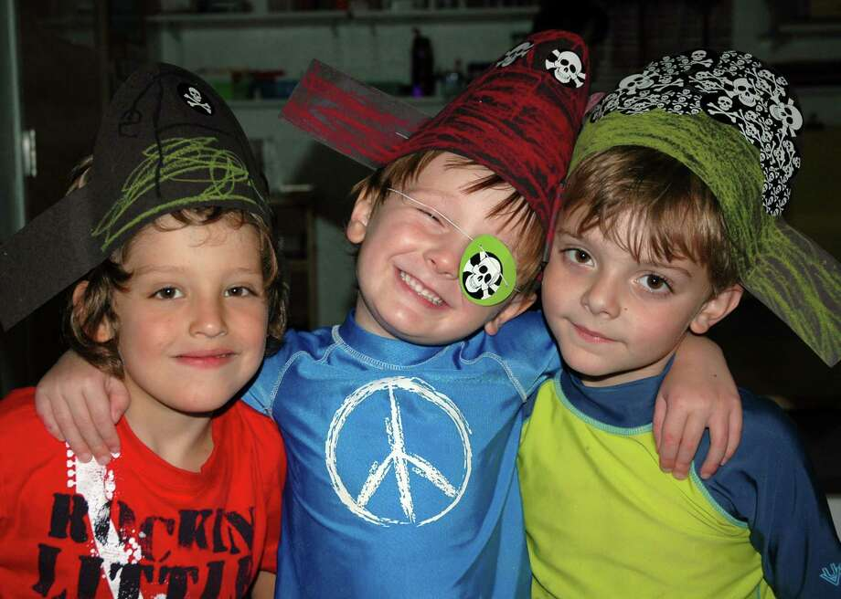 EJ Kollitides, Jayden Grayson and Jack Cudzil pose for a photo at Toddlertime in New Canaan, Conn. Photo: Contributed Photo