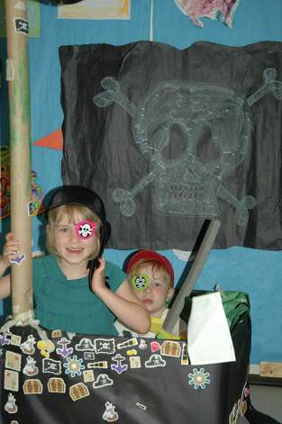 Emma LaGuarde and Caden Leslie play during Toddlertime's recent Pirate and Mermaid camp. New Canaan, Conn. Photo: Contributed Photo