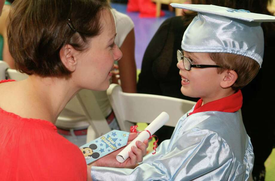 Pat-a-Cake Playschool graduate Dylan Rice and his mom Jennifer after the school's graduation ceremony Friday, June 22, 2012. Photo: David Ames / Greenwich Time