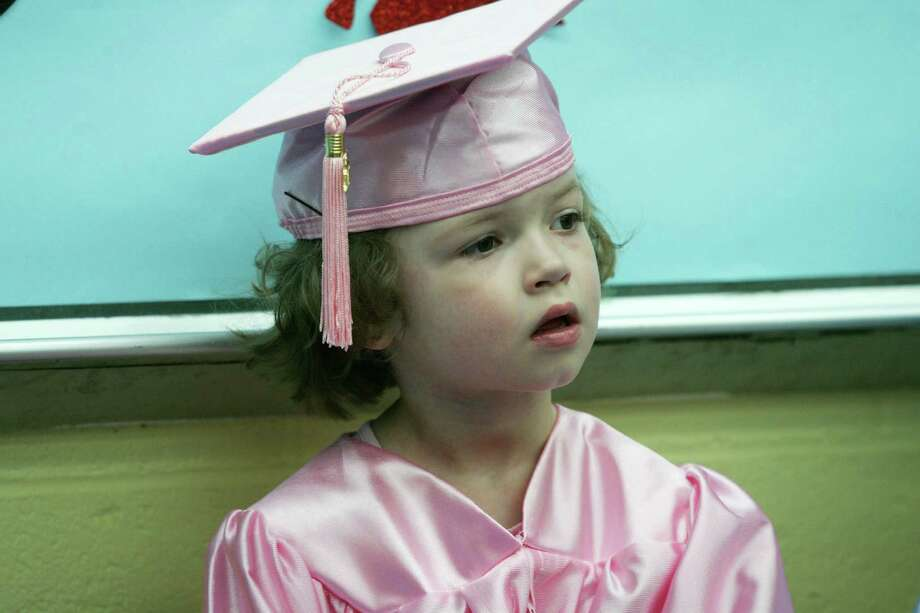 """Pat-a-Cake graduate Chelsie Glines, 4, during the school's """"moving on ceremony"""" Friday, June 22, 2012. Photo: David Ames / Greenwich Time"""