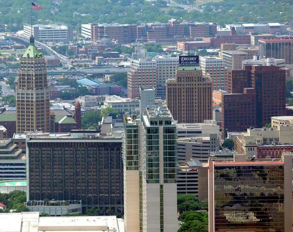 The San Antonio skyline looking from the east side toward the west is seen in this April 10, 2012 aerial photo.   (William Luther/wluther@express-news.net) Photo: William Luther, San Antonio Express-News / © 2012 WILLIAM LUTHER