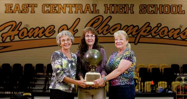 Clara Friesenhahn Rechner, from left, Mary Blocker Cover and Sharon LeSage Sendemer pose Wednesday June 20, 2012 in the gym at East Central High School. The three were members of East Central High School's 1958-1959 girls basketball team that made history as the first San Antonio girls team to reach the state semi-final game. Photo: William Luther, San Antonio Express-News / © 2012 WILLIAM LUTHER