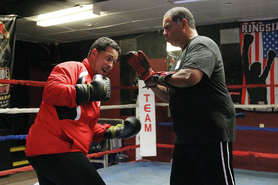 "Hector Camacho, Jr. (left) works out with trainer Fernando ""Tito"" Santiago at Team Morones Boxing Club on Wednesday, June 20, 2012. Camacho will be headlining a local card on Saturday at La Villita. Photo: San Antonio Express-News"