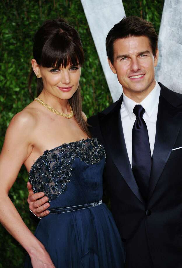 Tom Cruise and Katie Holmes:Ever since Holmes filed divorce papers, rumors are running rampant that Scientology is what tore the couple apart. Cruise is one of the most outspoken leaders in Scientology. Holmes was raised Catholic, but joined the church early in their relationship, about five years ago. Now some are speculating that Holmes is worried about raising her daughter in the church and wants full custody.   Photo: Alberto E. Rodriguez, Getty Images / 2012 Getty Images