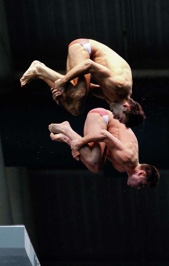 Nick McCrory and David Boudia perform a tuck at the Synchronized Men's 10m platform Final for the 2012 Olympic diving trials at the King County Aquatic Center in Federal Way on Thursday, June 21, 2012. Nick McCrory and David Boudia won their spot on the Men's team by a wide margin, entering the competition with a 114.84-point lead. Photo: LINDSEY WASSON / SEATTLEPI.COM