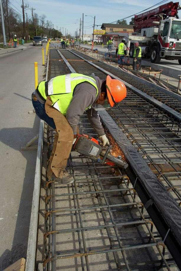 Juan Mota-Martinez of Houston Rapid Transit works on Metro's North Line light rail project. Photo: Brett Coomer / © 2012 Houston Chronicle