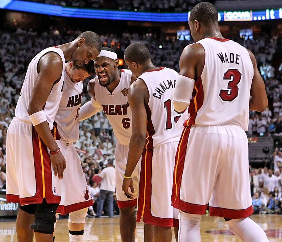 LeBron James of the Miami Heat huddles with teammates in the third quarter during Game 5 of the NBA Finals at the AmericanAirlines Arena in Miami, Florida, Thursday, June 21, 2012. (Al Diaz/Miami Herald/MCT) Photo: Al Diaz, McClatchy-Tribune News Service