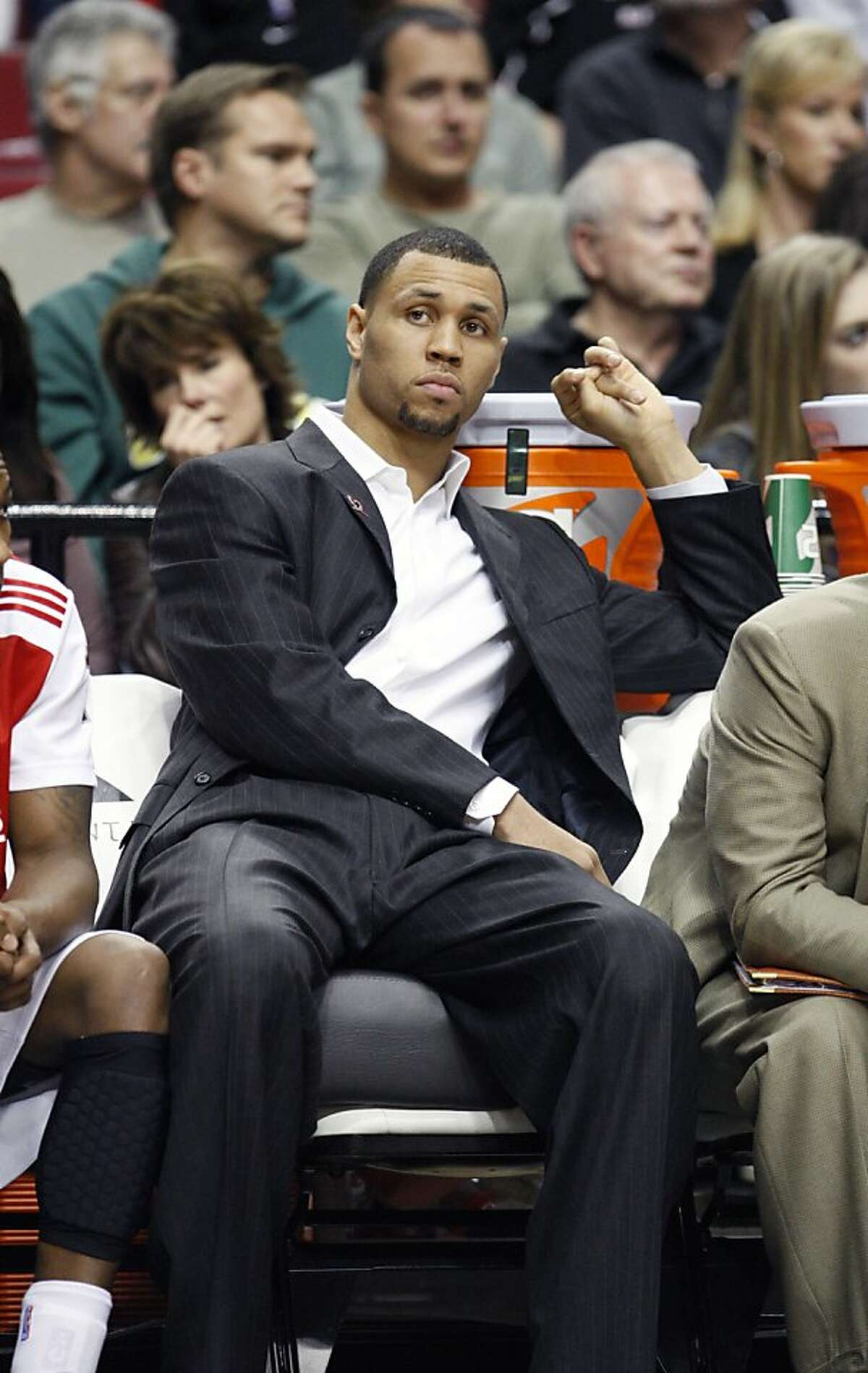 Portland Trail Blazers' Brandon Roy sits on the bench in the second quarter of an NBA basketball game with the Indiana Pacers Saturday, Jan. 22, 2011, in Portland, Ore.