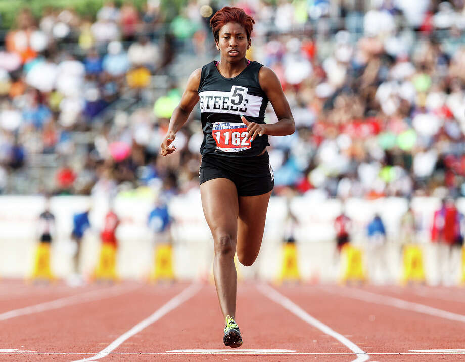 Steele's Domonique Smalls crosses the finish line of the 5A girls' 100-meter dash during the UIL state track meet at Mike A. Myers Stadium, University of Texas in Austin on May 12, 2012. Smalls ran a 12.38 in the event to finish ninth. MARVIN PFEIFFER/ mpfeiffer@express-news.net Photo: Marvin Pfeiffer/ Express-News