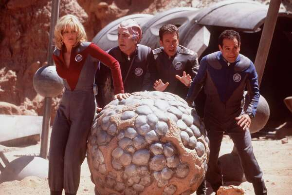 """Unexpectedly Drafted Into A Real Space Mission By Aliens Who Believe Their Science Fiction Series Is Real Life, Actors (L-R) Gwen Demarco (Sigourney Weaver), Sir Alexander Dane (Alan Rickman), Jason Nesmith (Tim Allen) And Fred Kwan (Tony Shalhoub) Find Themselves On A Hostile Alien Planet In Dreamworks Pictures' Science Fiction Action Comedy, """"Galaxy Quest."""""""
