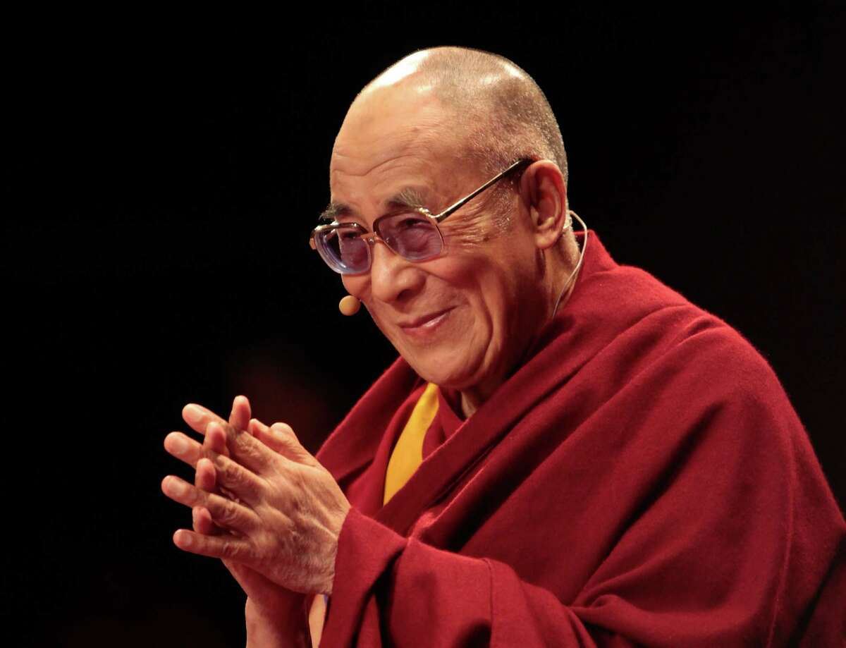 LONDON, ENGLAND - JUNE 19: His Holiness the Dalai Lama, 76, appears at Royal Albert Hall on June 19, 2012 in London, England. The exiled Buddhist Tibetan leader is on national tour of the United Kingdom with visits to Manchester, Leeds and London. (Photo by Rosie Hallam/Getty Images)