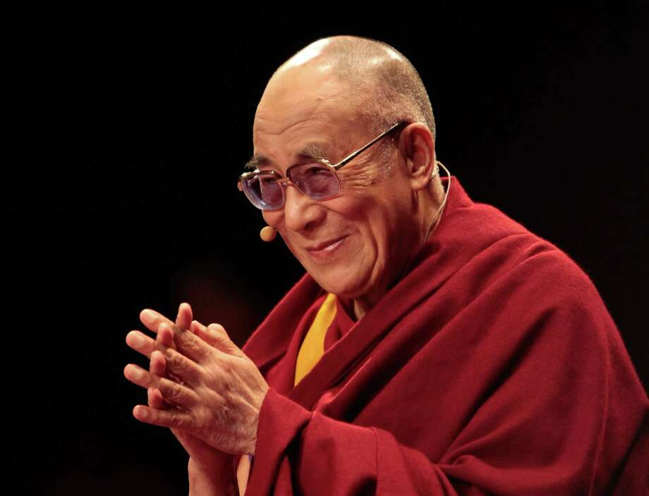 LONDON, ENGLAND - JUNE 19: His Holiness the Dalai Lama, 76, appears at Royal Albert Hall on June 19, 2012 in London, England. The exiled Buddhist Tibetan leader is on national tour of the United Kingdom with visits to Manchester, Leeds and London.  (Photo by Rosie Hallam/Getty Images) Photo: Rosie Hallam, Getty Images / 2012 Getty Images