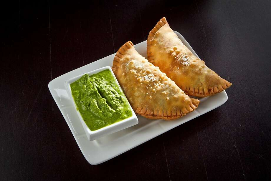 Cana Cafe's picadillo empanadas feature ground beef, a sofrito base and a mint parsley sauce. Photo: John Storey, Special To The Chronicle