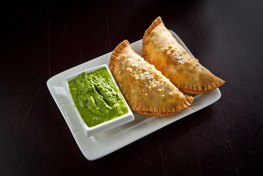 Cana Cafe's picadillo empanadas feature ground beef, a sofrito base and a mint parsley sauce.