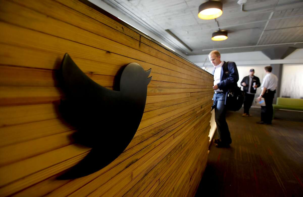 The reception desk, made from the wooden planks of the lanes of a bowling alley, greets vistors inside the lobby area, on Thursday June 21, 2012, as social networking company Twitter has finished moving into the historic Market Square building at 1355 Market St. in San Francisco, Ca.