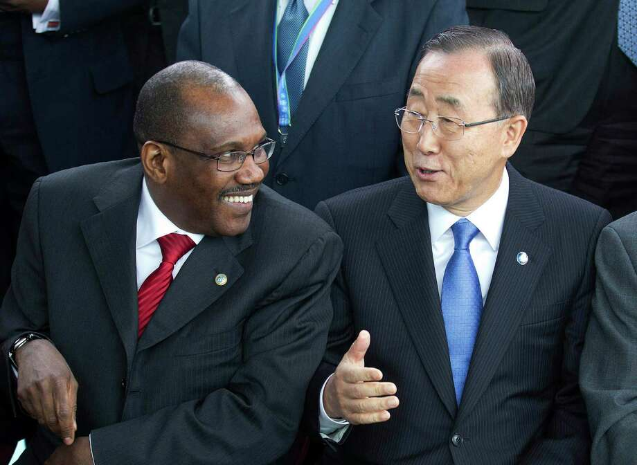 FILE - In this April 13, 2012, file photo United Nations Secretary-General Ban Ki-moon, center, speaks with Hamadoun Toure, Secretary-General of the International Telecommunication Union (ITU),during a photo session of the UN Chief Executive Board in Geneva, Switzerland. Secret negotiations, preparing for a first-ever summit on international telecommunications, have sparked a wave of rumors, the juiciest of which has the UN seizing control of the Internet from a coalition of nongovernmental organizations that establish web policies, standards and rules. Toure, who will be running the World Conference on International Telecommunications in Dubai this December calls the rumor ?ridiculous.? (AP Photo/Keystone, Salvatore Di Nolfi) Photo: Salvatore Di Nolfi / Keystone