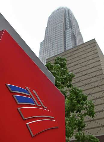 FILE -- An April 19, 2012 file photo shows Bank of America's corporate headquarters  in Charlotte, N.C.  Moody's Investors Service Thursday June 21, 2012 has lowered the credit ratings on some of the world's biggest banks, including Bank of America. Photo: AP