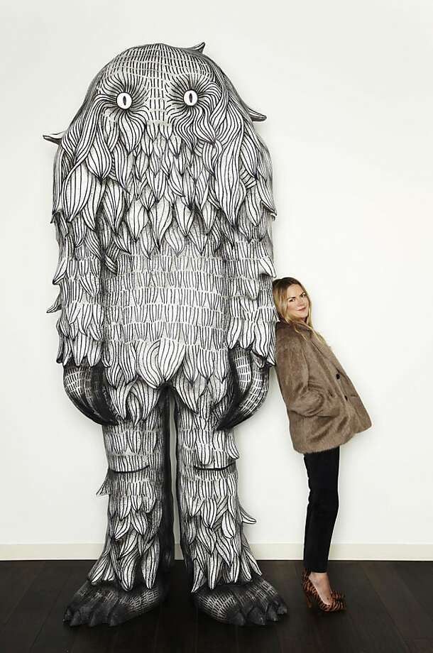 "Mulberry Creative Director Emma Hill poses with the monster. The fall 2012 collection was inspired by ""Where the Wild Things Are,"" both the Maurice Sendak book and Spike Jonze movie version. Photo: Mulberry"