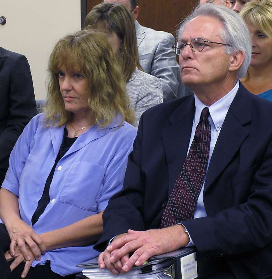 Dr. Ann Kristin Neuhaus watches as the Kansas State Board of Healing Arts decides to revoke her license over referrals of patients she made in 2003 for late-term abortions, Friday, June 22, 2012, in Topeka, Kan. Next to her is one of her attorneys, Bob Eye. The State Board of Healing Arts ratified an administrative judge's earlier decision to strip Dr. Ann Kristin Neuhaus of her license. Neuhaus provided second opinions that Tiller needed under Kansas law to perform some late-term abortions at his Wichita clinic. Tiller, one of a few U.S. physicians known to perform abortions in the final weeks of pregnancy, was shot to death in May 2009 by a man professing strong anti-abortion views.  (AP Photo/John Hanna) Photo: John Hanna, Associated Press