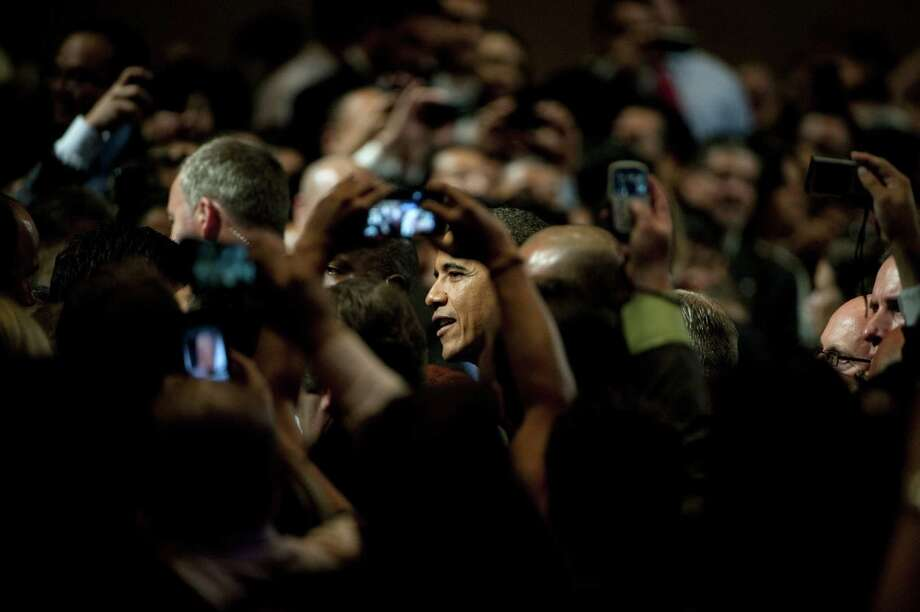 President Barack Obama greets the audience at the 29th annual NALEO conference Friday in Lake Buena Vista, Florida. The National Association of Latino Elected and Appointed Officials also hosted Republican candidate Mitt Romney. Photo: Edward Linsmier / 2012 Getty Images