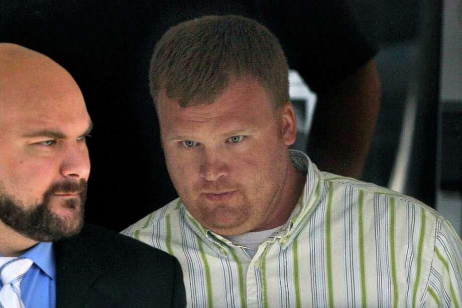 Potential testimony by Matt Sandusky, shown leaving court last week, helped keep his father off the stand. Photo: Gene J. Puskar / AP
