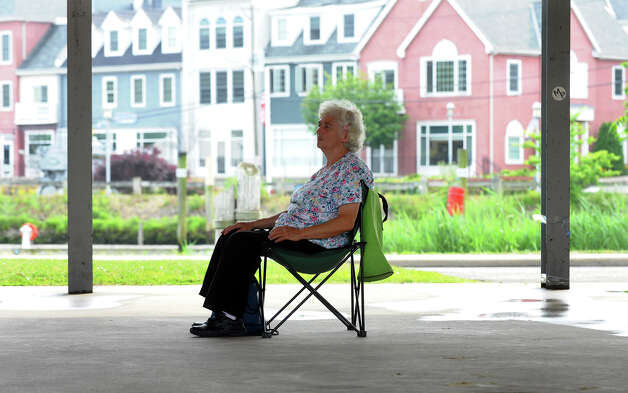 Joann Procino sits in the shade of the pavillion awaiting the Milford Concert Band to perform as part of the city's Summer Concert Series in downtown Milford, Conn. on Friday June 22, 2012. Photo: Christian Abraham / Connecticut Post