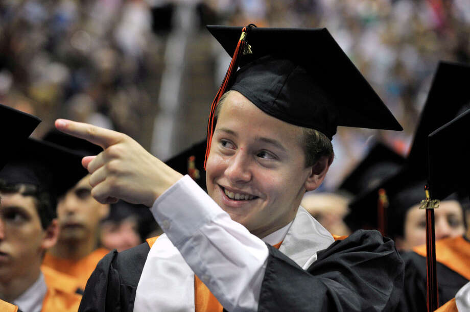 Thomas Parks recognizes a fellow classmate as they receive their diploma during the Ridgefield High School graduation at the O'Neill Center at Western Connecticut State University's westside campus on Friday, June 22, 2012. Photo: Jason Rearick / The News-Times